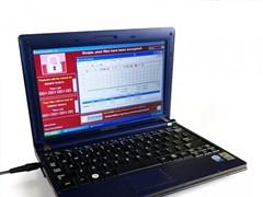 21世纪最惨笔记本电脑拍出120万美元:身中六大病毒